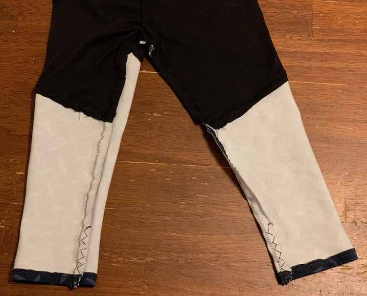 Closeup of the bottom inside of the pants showing the zig zag stitching at the bottom of the legs.