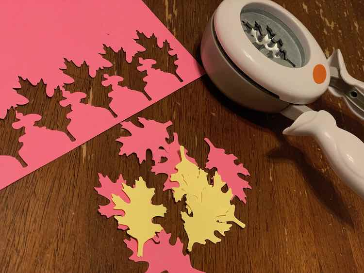 Bought a Fiskars oak leaf punch for the leaves so punched a bunch leaves out of a sheet of yellow and (Ada-chosen) pink card stock.