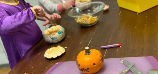 We started by cutting the tops off of the pumpkins (me), and then using grapefruit spoons and our fingers to pull out the guts. I carved a small and simple face on my pumpkin and gave Ada a crayon to mark hers. I ended up cutting a simple heart on Ada's and left Zoey's plain as I realized the solution might spill out before it could be mixed.