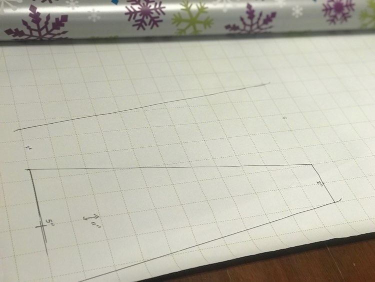 At first I started creating a template for the shape I needed to cut but then decided I could just cut them out as I went with my quilting ruler. Writing on the wrapping paper was the perfect way to plan what I'd need to do before jumping in.