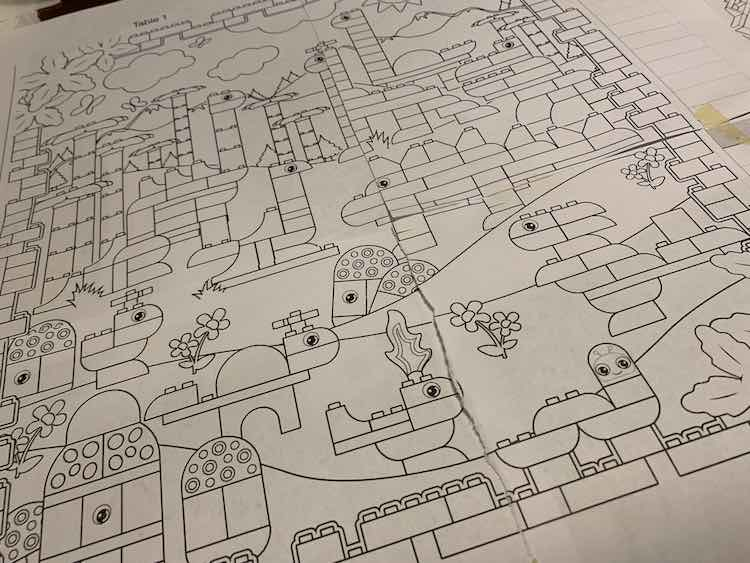 Taped together page with dinosaurs bigger than the single coloring page I used and smaller than the other version in the PDF.