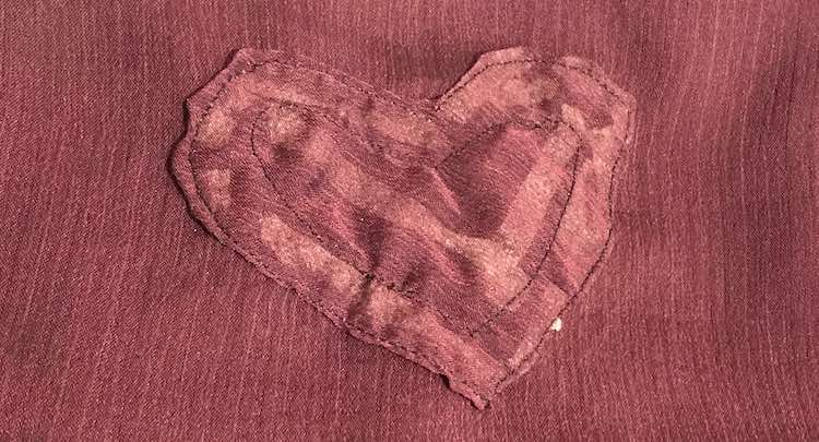 Front of the heart on the camisole after it was sewn on. You can see the tape behind the heart.
