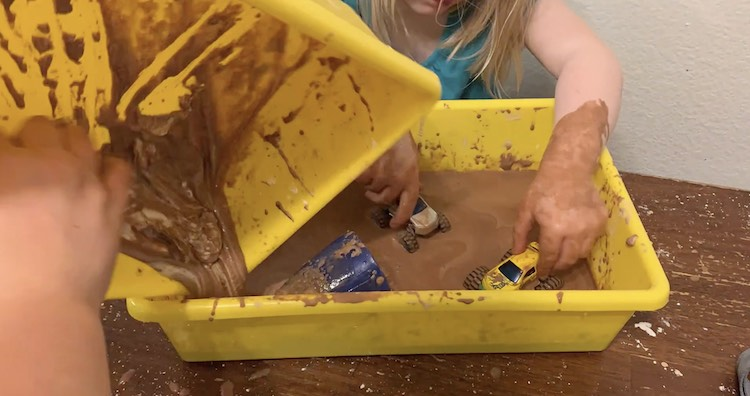 Pouring Zoey's oobleck in with Ada's,