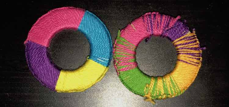 The washer on the left has abrupt colors changes starting with pink, blue, yellow, and blue. The washer on the right also consists of four colors (pink, purple, darker yellow, and green) but the more gradual changes almost trick your eyes making you think there are five colors.