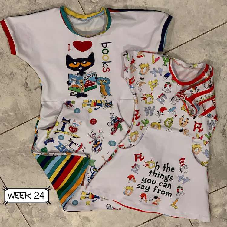 """The larger dress on the left and under the smaller has Pete the Cat on it and it says """"I heart books"""". The smaller dress has the panel on the skirt portion rather than the bodice and is Dr Seuss themed with """"Oh the things you can say from A to Z"""""""