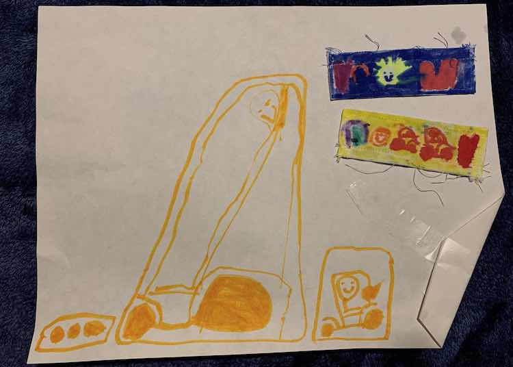 The back of Ada's plackets along with the picture she drew for me showing both a large and small vehicle.