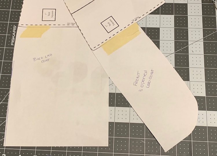 The altered back bodice piece is laid out under the altered front bodice piece easily showing the changes to the bottom of the raglan pattern.
