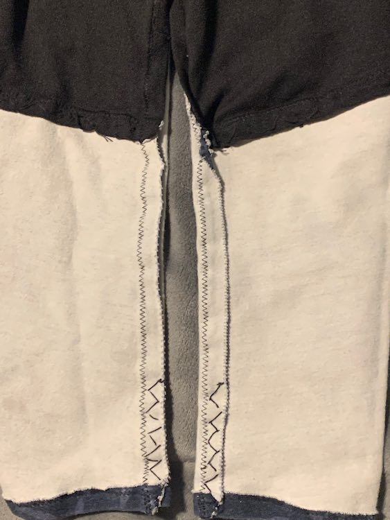Closeup of the inside of the pants showing the hand stretch stitches.
