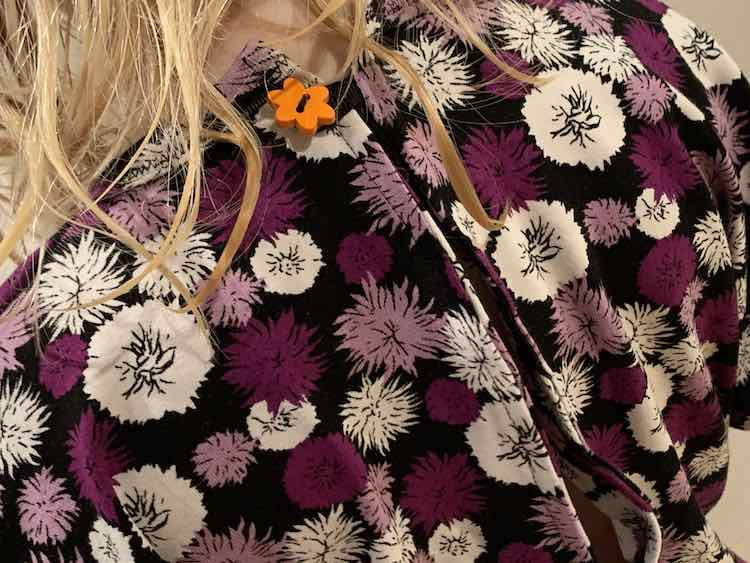 Closeup of the knit placket on Zoey's top.