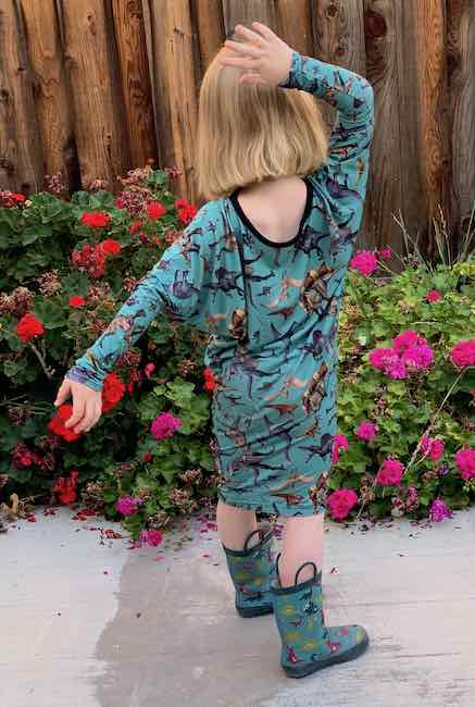 Posing while wearing the dress with matching dinosaur rubber boots.
