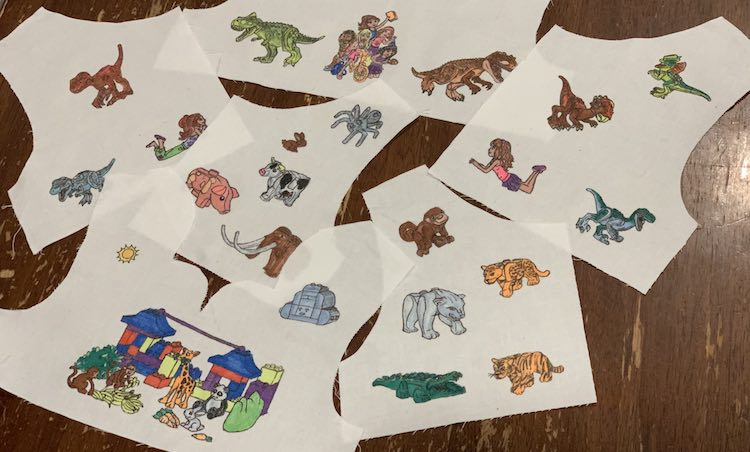 Overview of all six pattern pieces for the two dresses. The bottom three are the DUPLO®-esque pieces showing the animals while the upper three piecea are Ada's LEGO® dinosaurs and Friends.