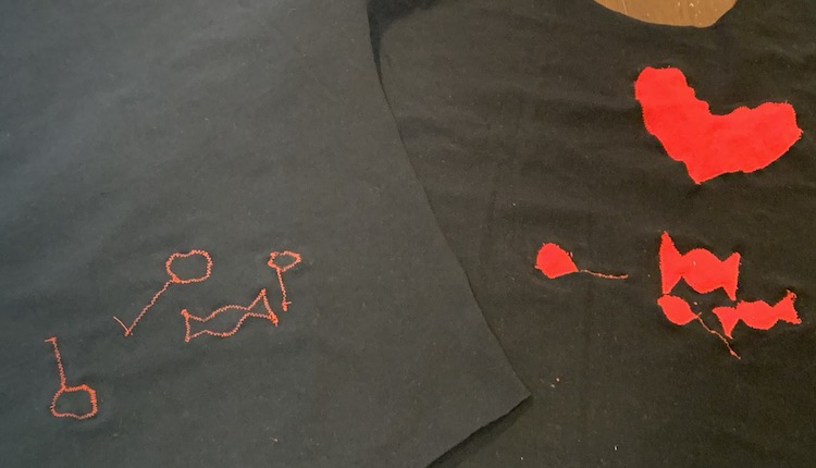 Image shows the front of the shirt, right side up on the right side of the photo, and the back side of the shirt, wrong side up on the left so you can see the difference between the front (red shapes) and back (thread outlines) of the fabric.