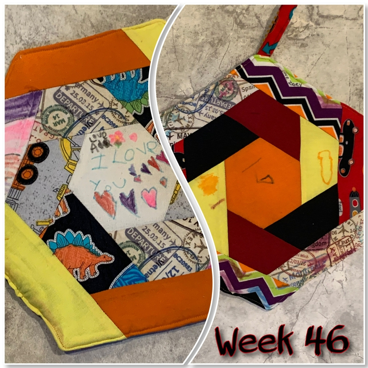 "Image is two views of the same hexagon potholder so you can see either side. They're separated by a wavy vertical line and at the bottom it says ""Week 46"" in black and red."
