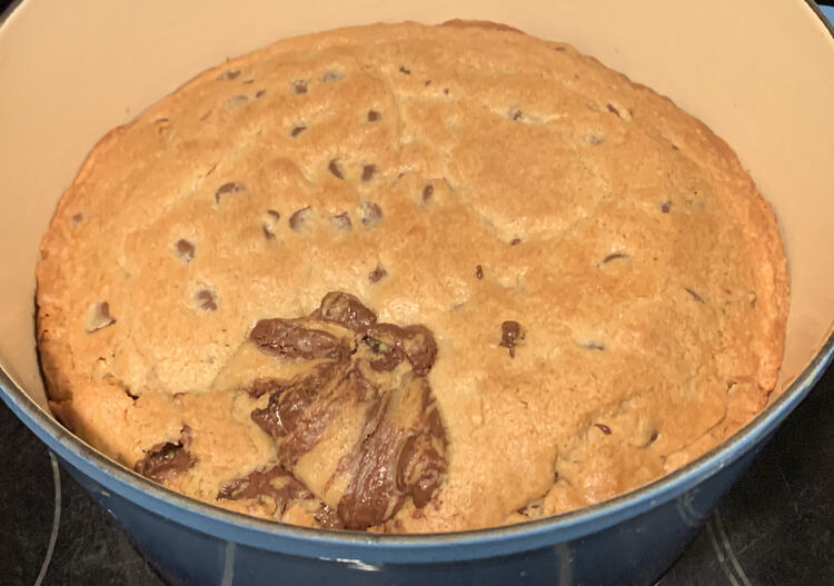 Image shows a cookie filling the bottom of my blue Dutch oven.