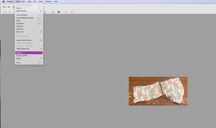 Image shows a very small shirt image surrounded by grey. The top File menu is open and the chose Export... is highlighted in purple.
