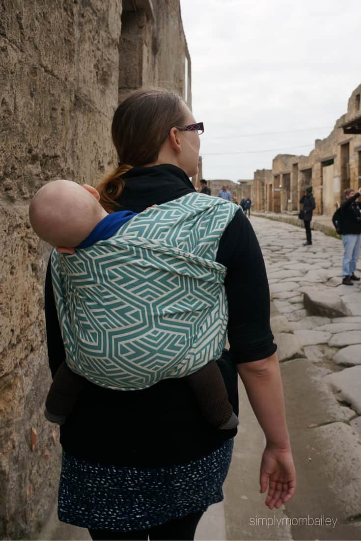 woman wearing baby in a woven wings double hammock  in Pompeii Italy