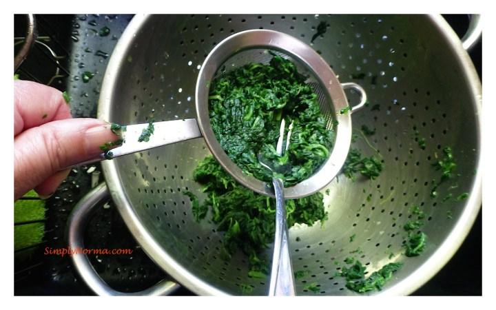Strain the spinach to remove the liquid