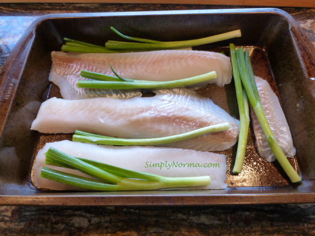 Add scallions to the cod