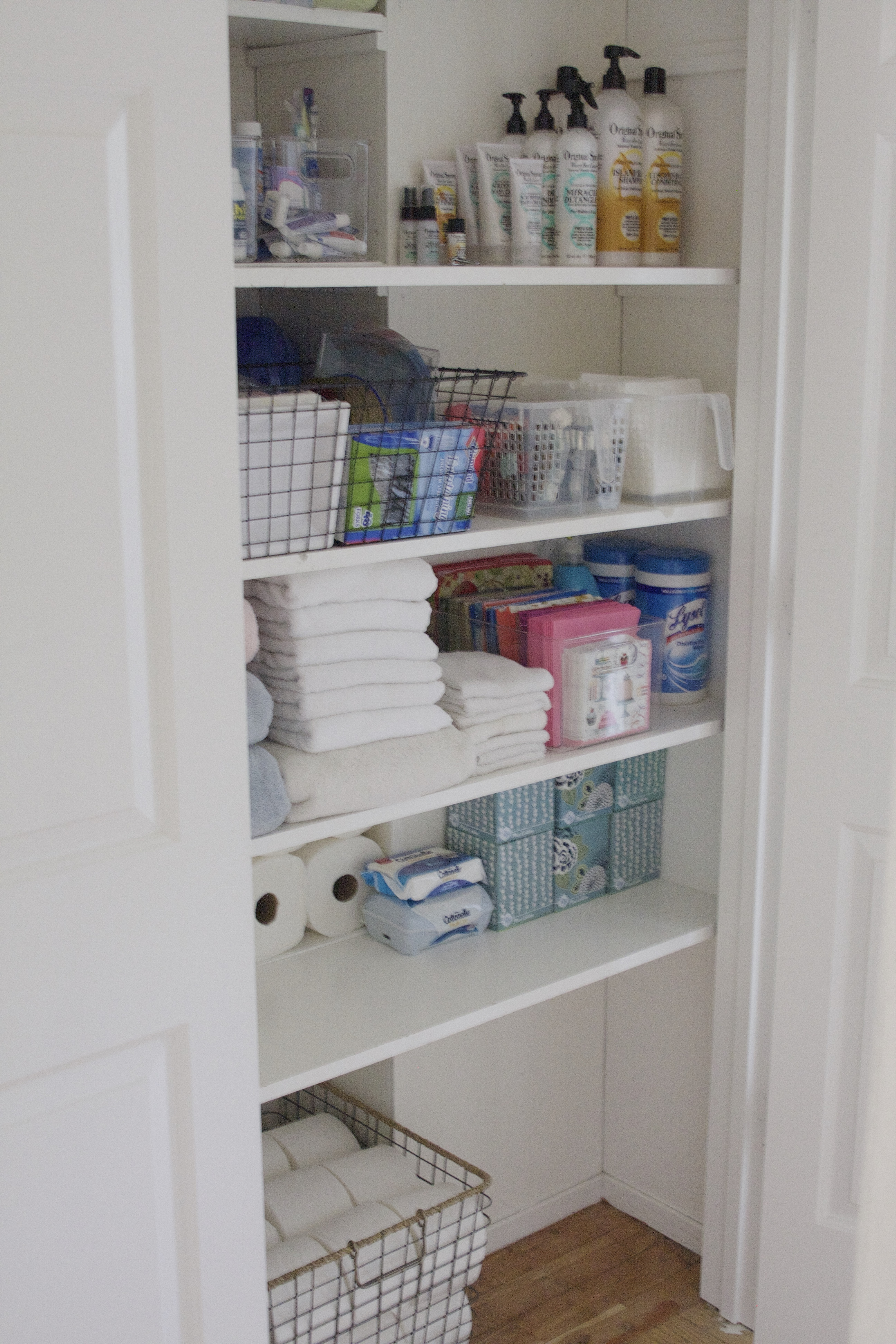 organized bathroom closet - simply organized