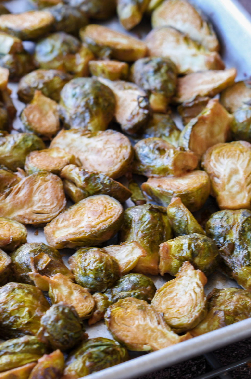 Maple-Dijon Roasted Brussel Sprouts come together with 5 minutes prep. Healthy enough to serve as a Thanksgiving side, but simple enough for family dinner!