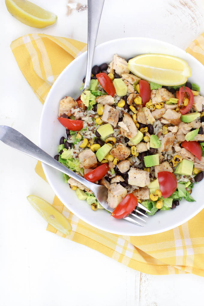 This 30-Minute Healthy Chicken Burrito Bowl starts with a layer of leafy romaine and is topped with whole-food ingredients like black beans, fire roasted corn, seasoned quinoa, creamy avocado and juicy tomatoes.