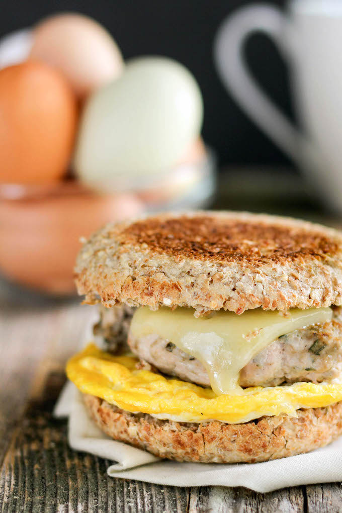 Healthy Freezer-Friendly Breakfast Sandwiches are make-ahead and whole-food friendly. Whole-grain English Muffins, farm fresh eggs and homemade turkey sausage make this the ultimate breakfast sandwich.
