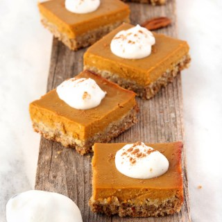 Hearty Pumpkin Pie Bars are a fun twist on traditional pumpkin pie. Crunchy oat n' almond crust topped with classic pumpkin filling. #wholefood #glutenfree