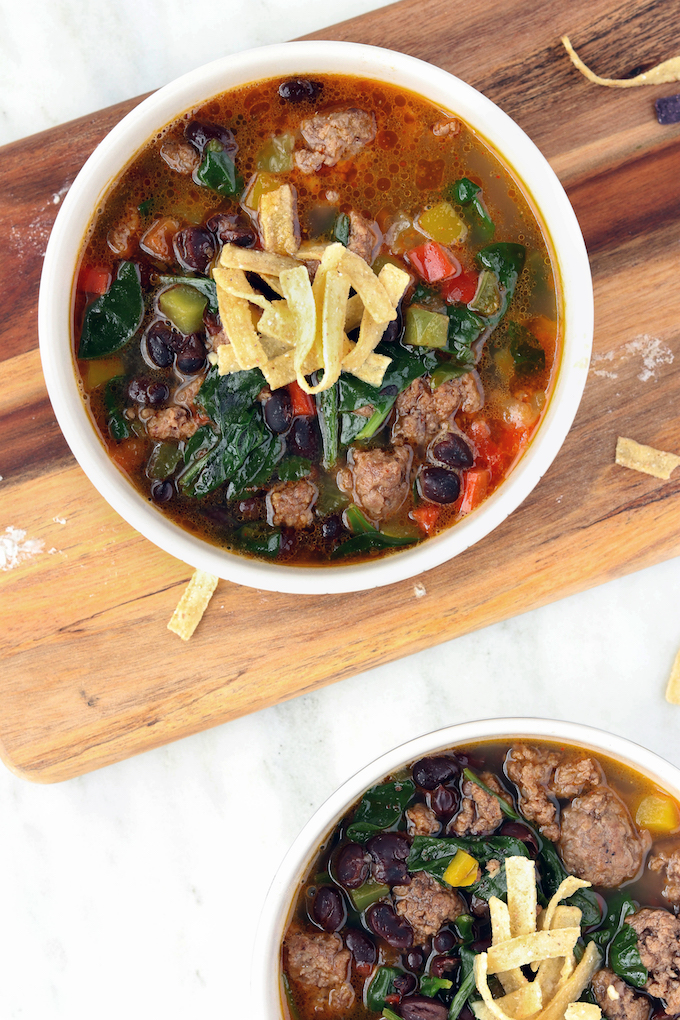 Simple, 30-minute Veggie Loaded Taco Soup is infused with tons of Mexican seasoning, black beans, bell peppers, and leafy greens. A hearty, nutrient dense, flavorful soup that's perfect for a 1-pot Winter meal.