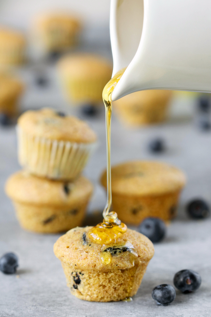 Perfect whole-food Mini Blueberry Corn Muffins made with 9 ingredients! Naturally sweetened, crumbly, tender and studded with bursts of juicy blueberry.