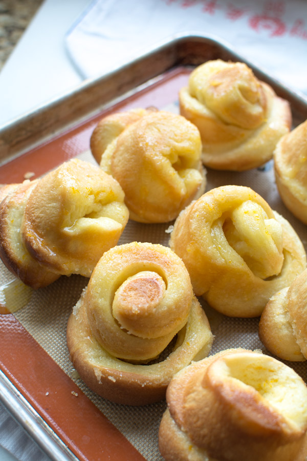 baked orange rolls tipped out of tin