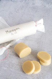 sliced marzipan wrapped roll in background