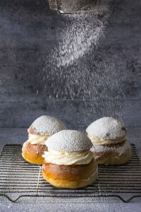 Semlor buns with dusting of powdered sugar