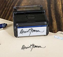 Signature Stamp and Stamp Impression Resting on Manila Folder