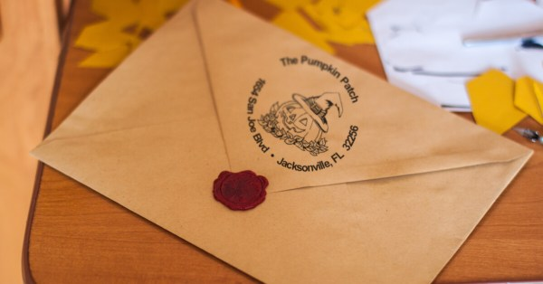 Brown Envelope Sealed with Wax and Halloween Return Address Stamp Impression