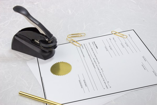embosser-with-gold-seal-and-documents