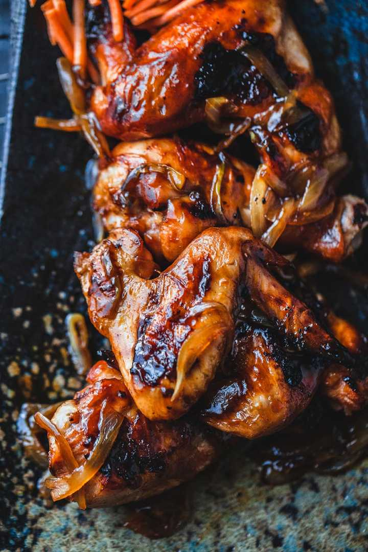 Spicy Thai Chicken Wings - an easy recipe for baked wings topped with caramelised onions with sticky sweet flavor. #thaichickenwings #chickenwings #thaichicken #thaifood #thairecipes