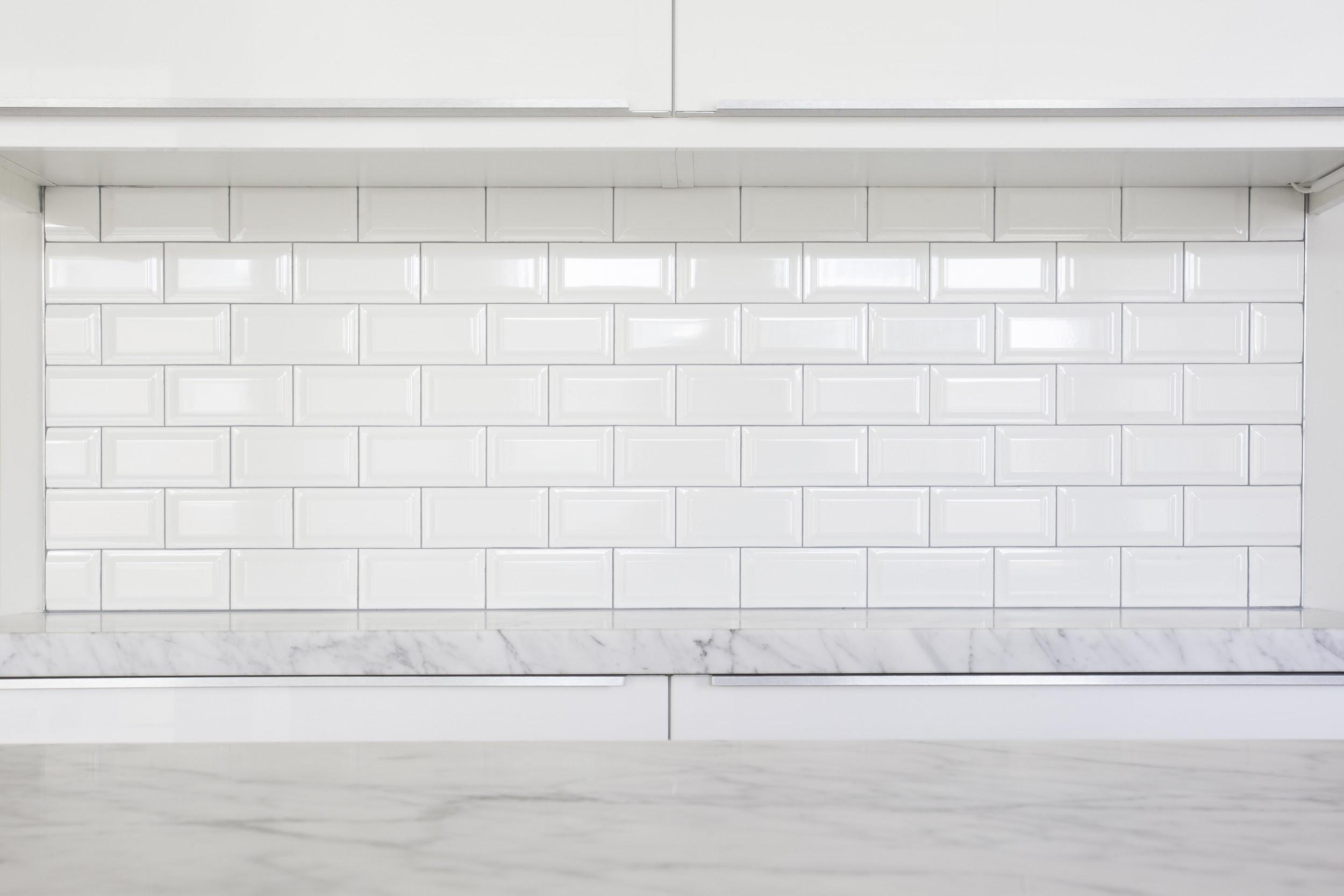 How To Install A Glass Tile Backsplash In A Kitchen Simply Sweet