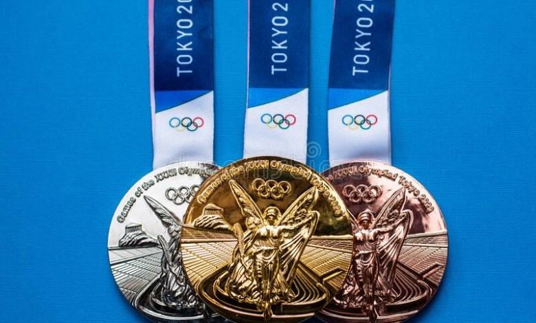 1627136205 summer olympic games tokyo april japan gold silver bronze medals xxxii blue background 220507183