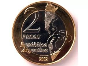 Billete de $100 de Evita y moneda de Islas Malvinas en circulación