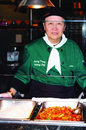 Jimmy Treng serves as wokery chef in the Tartan Marketplace. The Marketplac is one of several dining options on campus and is located in the basement of Building 7. --photo by Mary Edwards