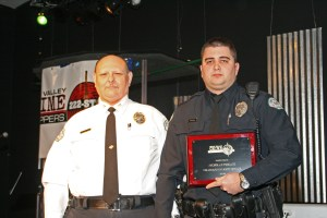 Nicholas Toscani (right) stands with Police Chief Charles Gift at the Miami Valley Crime Stoppers awards.