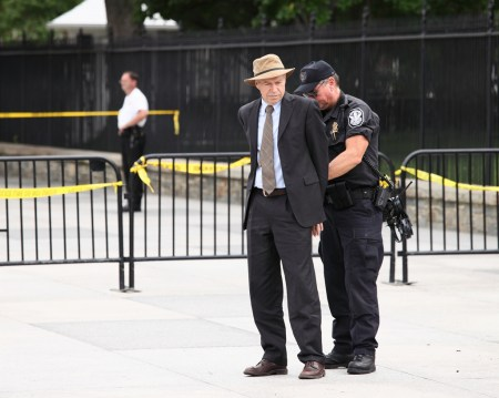 James Hansen getting arrested at an August 2011 protest against the Keystone XL pipeline outside the White House
