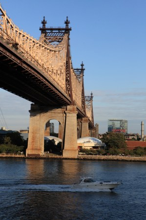 Boat passing 59th Street Bridge