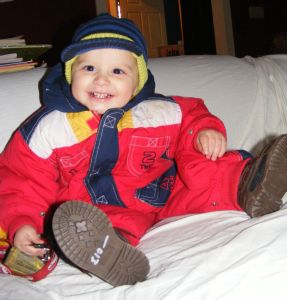 Kaleb Grinning in Snowsuit