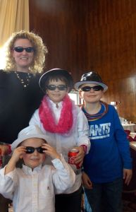 Kaleb, George, Noah and Me in Dark Sunglasses at a party