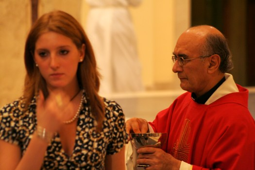 Catholic Priest and Woman with he back turned