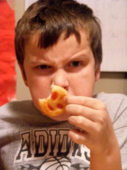 "Noah with ""bloody"" smiley fries"