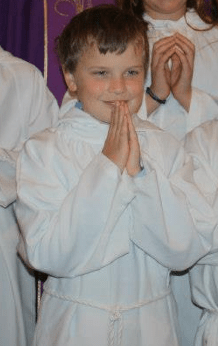 Noah - Hands fodled as he is made an altar server for the first time.