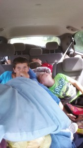 sleeping boys in the car