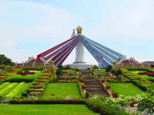 Phillipines statue of Jesus depicting Divine Mercy overlooking immense gardens